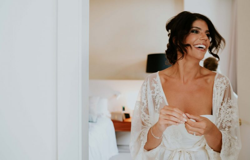 a beautiful bride with her makeup applied and hair styles in preparation for her wedding in venice