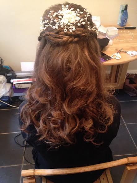 A lady showcases her bridal hair style by Rugby hair dresser