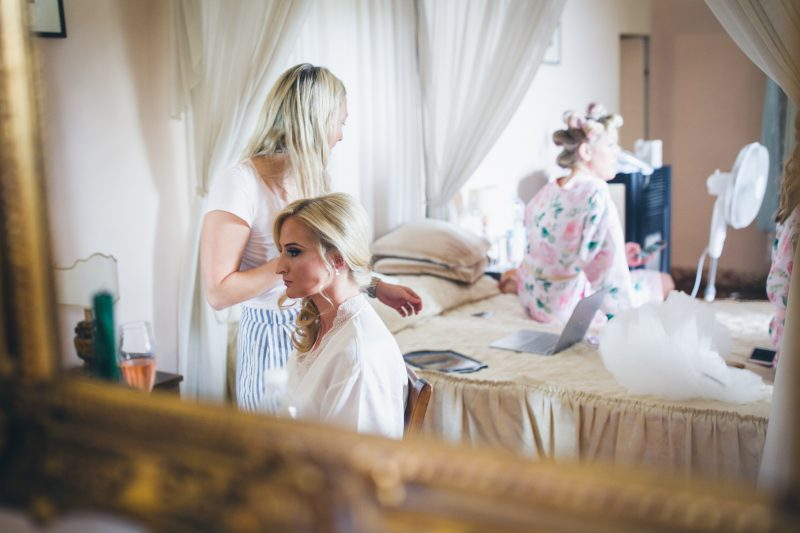 a bride showcases her wedding hair