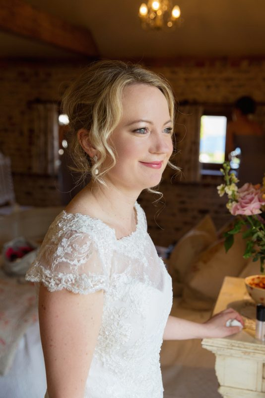 Bride showcases her hair and makeup on her wedding day