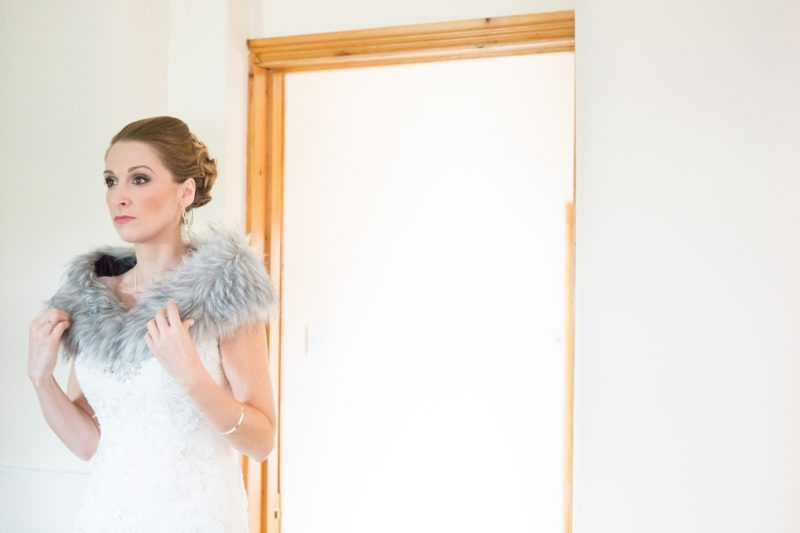 Cotswolds bride in Wedding Hair and Makeup with blue fur draped around her shoulders.