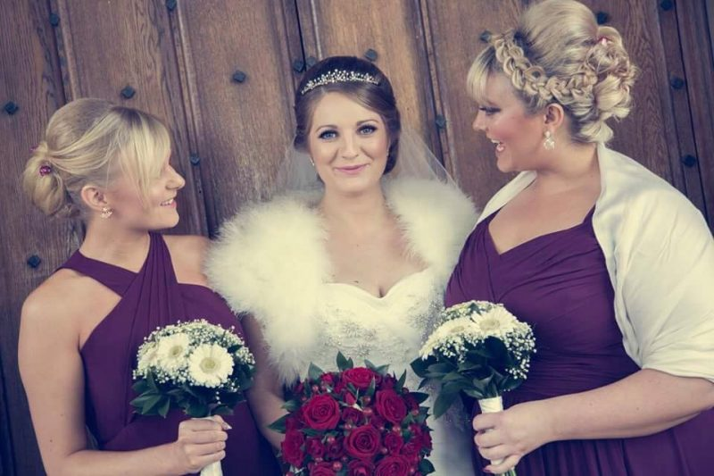 Gloucestershire Bride and Bridesmaids in full hair and makeup holding bouquets.