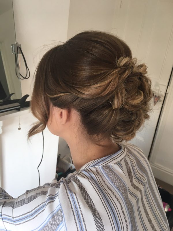 A female showcases the her wedding hair style from behind