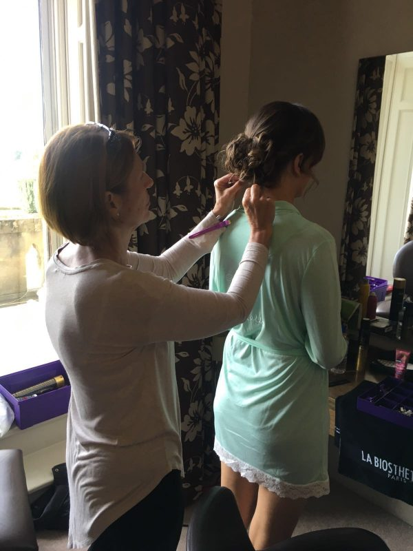 a female showcases her hair styled by Warwickshire based hairdresser
