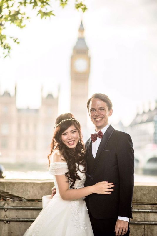 oriental bride smiling with her groom in london