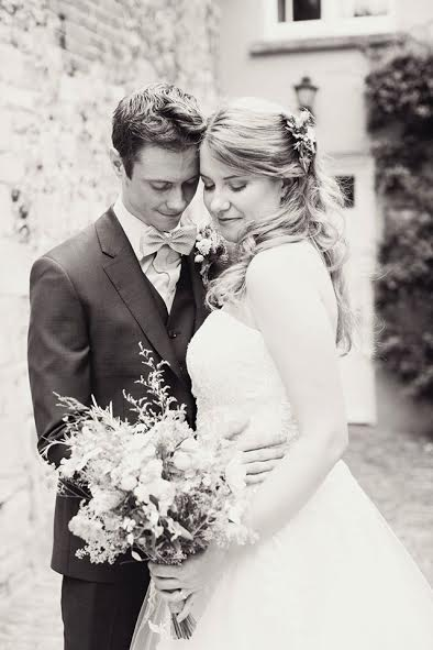 cotswolds bride in Wedding Hair and Makeup standing outside with groom in black and white.