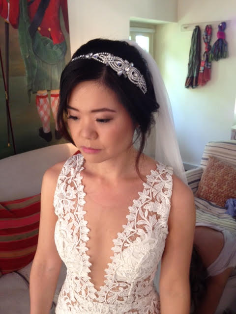 Cotswolds bride in Wedding Hair and Makeup, wearing a lacy white dress and a band of lace in her hair