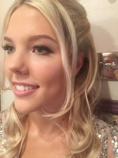 Cotswold bride smiling in wedding makeup.