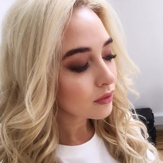 Blonde bride in makeup.