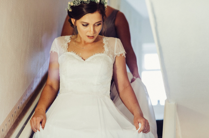 Guildford bride in hair, makeup and white dress.