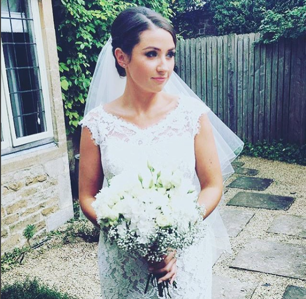 kent bride in Wedding Hair and Makeup stood outside holding bouquet in white dress.