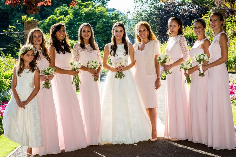 London bride and bridesmaids outside in hair and makeup.