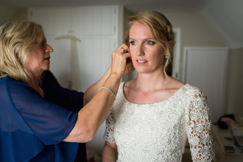 A lady with her hair professionally styles and makeup applied for her wedding day