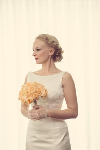 kent bride in Wedding Hair and Makeup looking to the right holding orange bouqet.