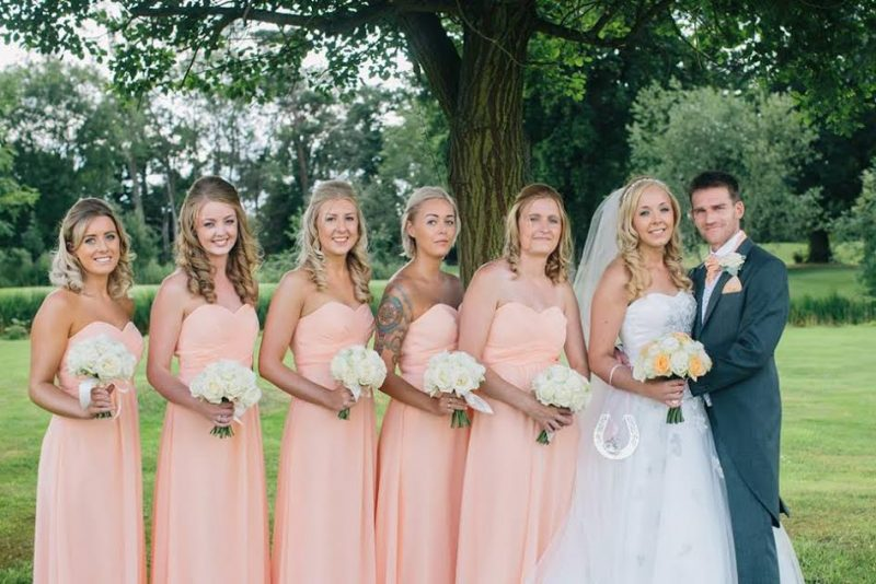 Cotswolds bride, bridesmaids and groom in wedding makeup and hair.