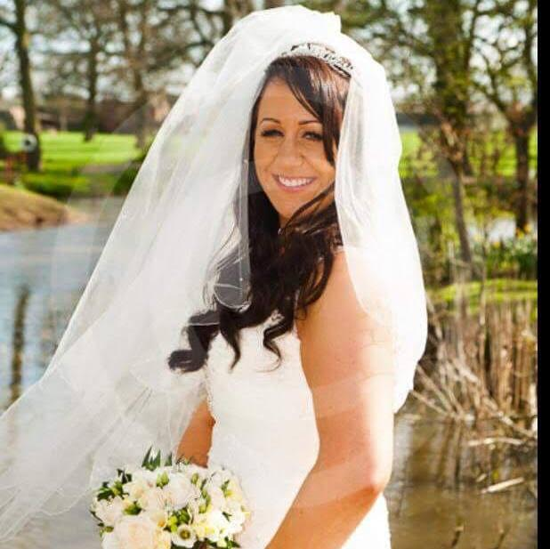 bride in wedding makeup and hair outside