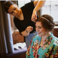 hair stylist tweaked the hairstyle of a bride