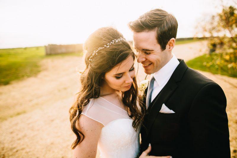 a bride showcases her wedding hair
