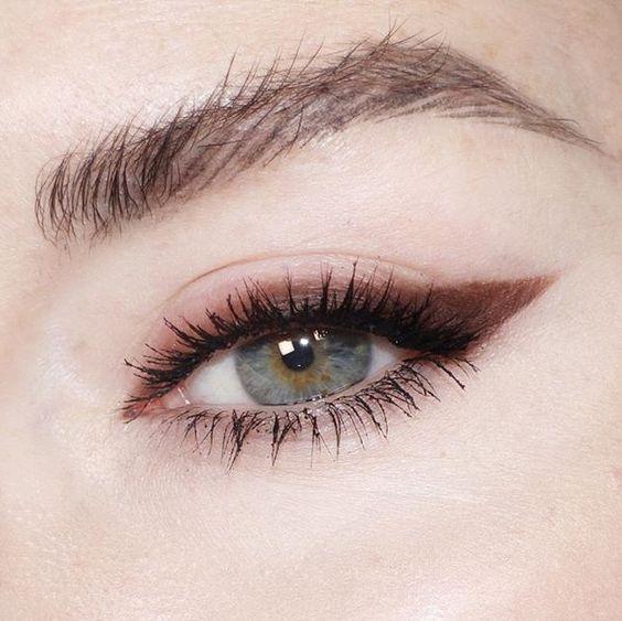 inspirational image of eyeliner flicks and lashes coated in mascara