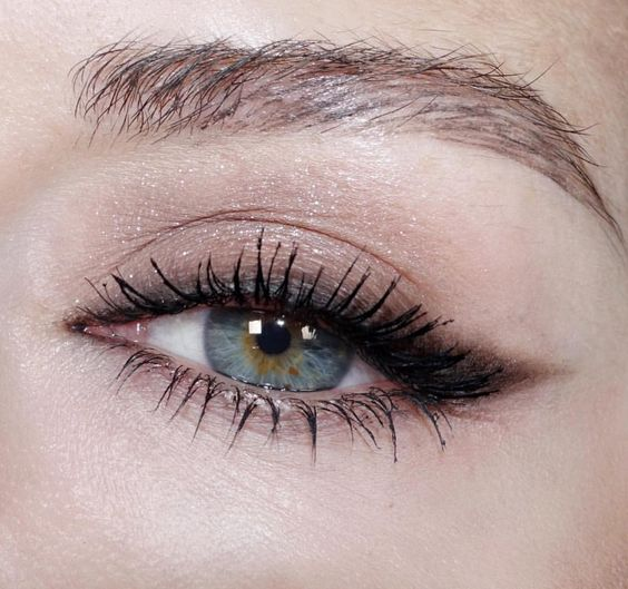 inspirational image of eyeliner flicks and lashes coated in mascara