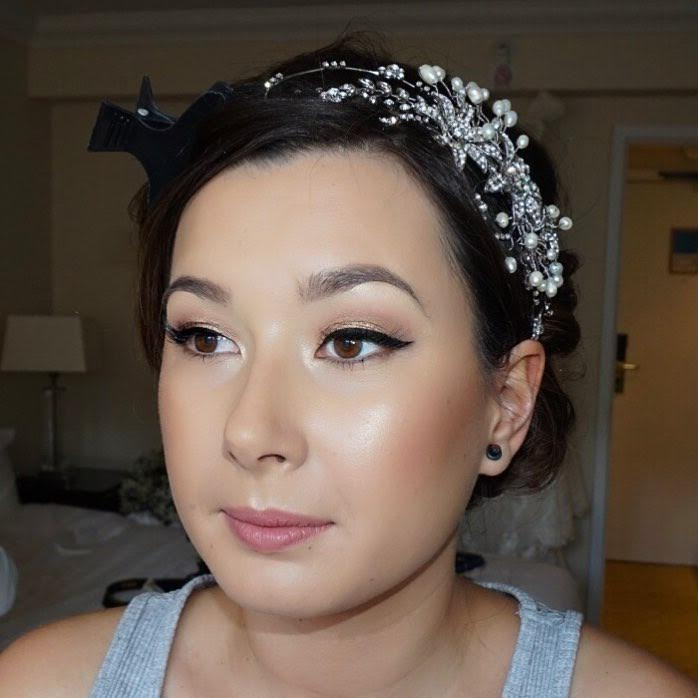 bride with face of makeup on her wedding day