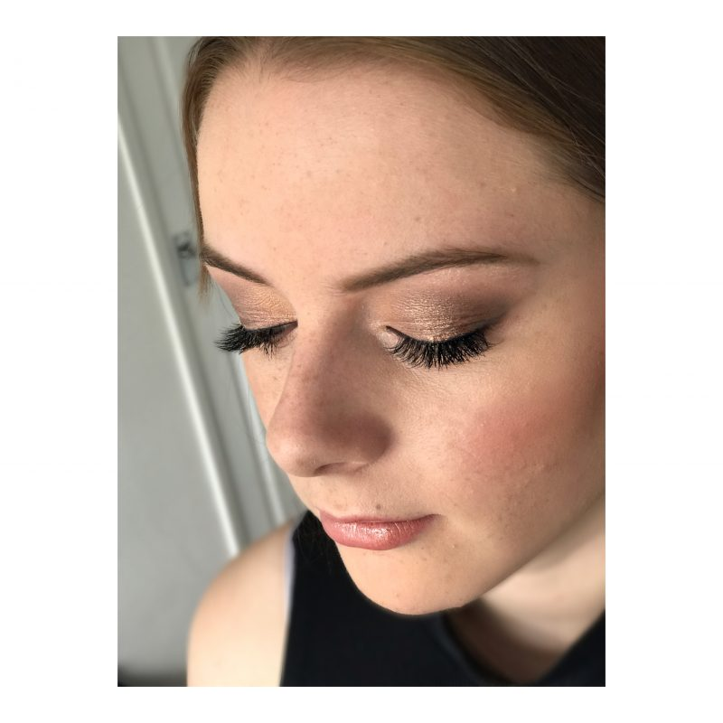 A female showcases her professional makeup by Cambridge artist
