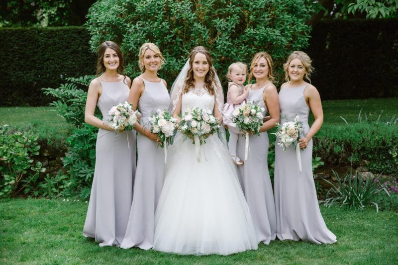 bride and her bridesmaids on her wedding day