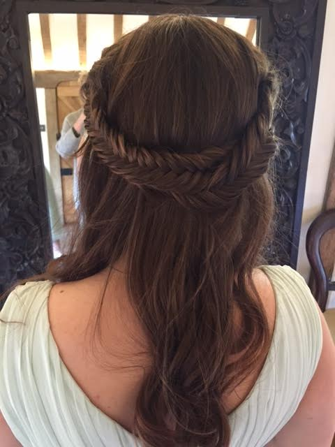 bride with her hair styled on her wedding day