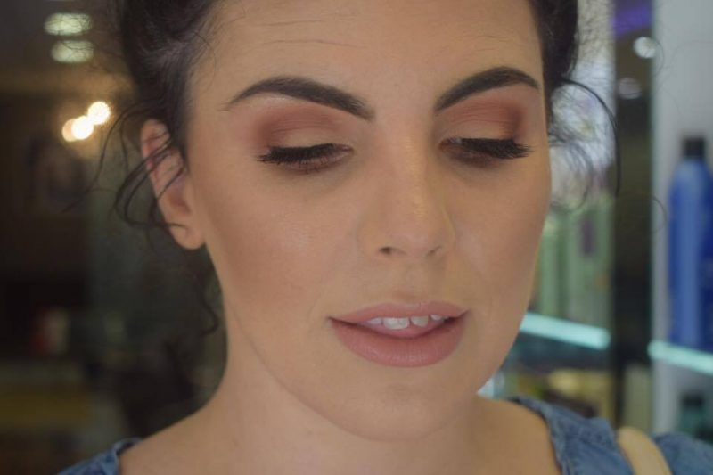 A lady gazes down to showcase her face of makeup by Solihull Makeup Artist