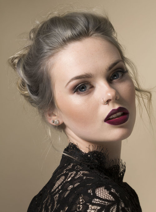 A blonde model showcases her face of makeup y west midland makeup artist