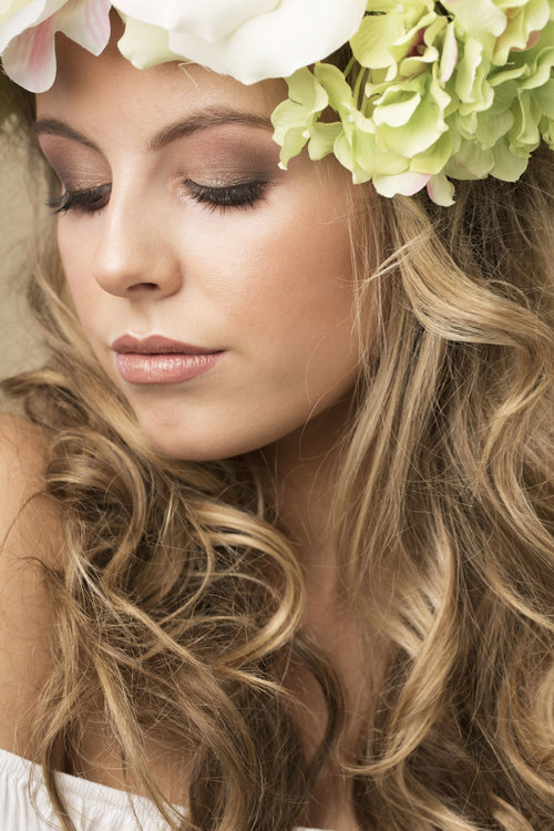 Blonde lady showcases her face of makeup y west midland makeup artist
