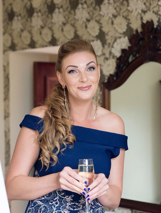 a bridesmaid showcases her face of makeup by west midland makeup artist