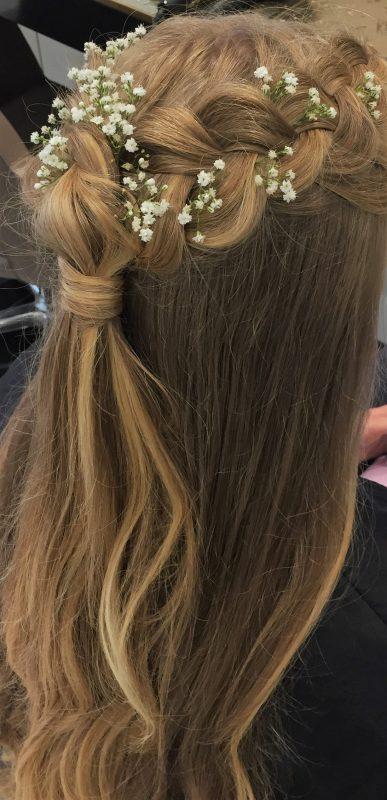 A bride showcases skills by Wedding hair stylist in Devon