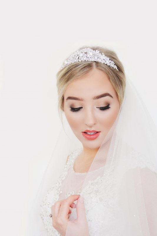A bride showcases her face of makeup by Worcestershire makeup artist