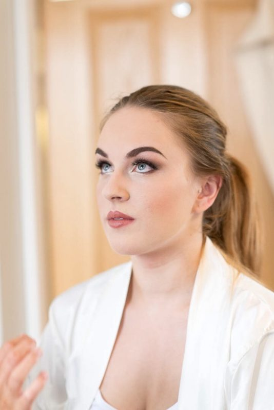 A bride showcases skills by Worcester makeup artist
