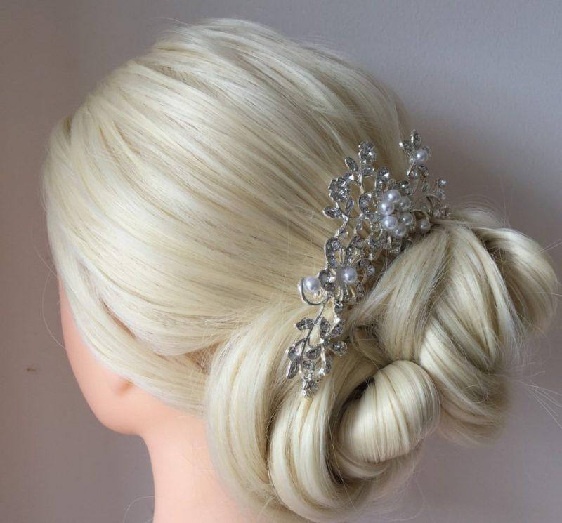 A hair stand showcases skills by Wedding hair stylist in Devon