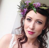 A bride showcases her face of makeup on her wedding day by west midland makeup artist