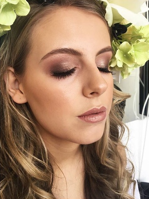 a lady showcases a face of makeup by west midland makeup artist