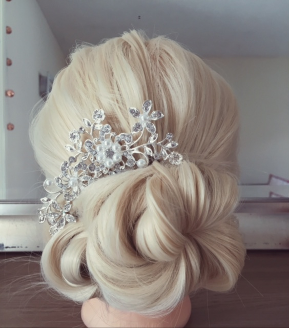 A hair stand showcases skills by Wedding hair stylist in Devon